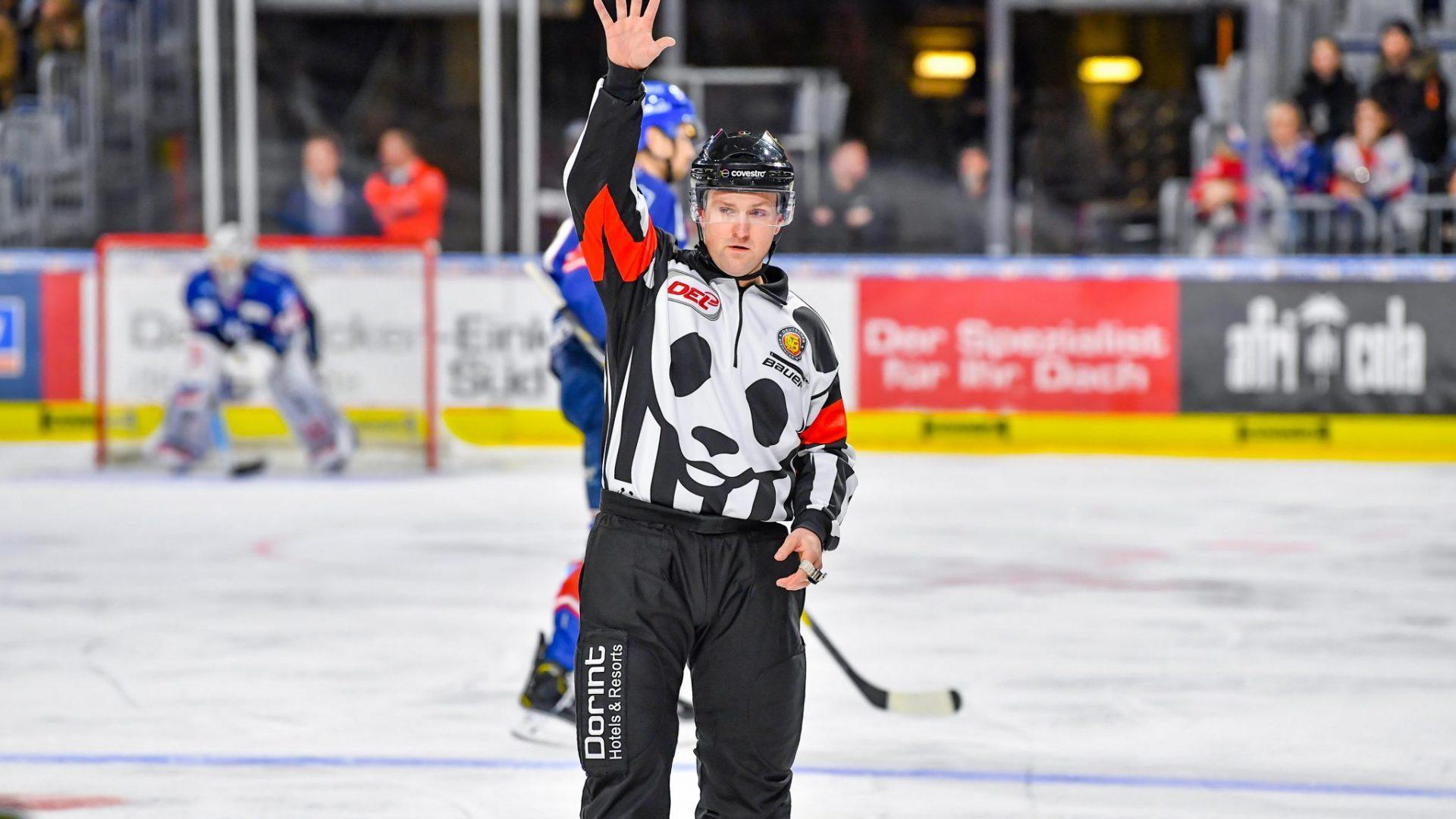 Die Eishockey-Schiedsrichter der DEL werden ihre Spiele künftig im Panda-Trikot pfeifen. Der Panda war beim Eröffnungsbully live dabei. © City Press